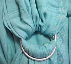 Sleeping Baby Productions ring sling - I love mine and would get 10 more if I could!