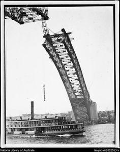 Ferry passing beneath the construction of the Sydney Harbour Bridge, Sydney, ca. 1915 [picture].