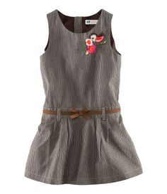 $19.95 Dress in woven fabric with an appliqué at top, attached imitation leather belt at waist, and concealed back zip.