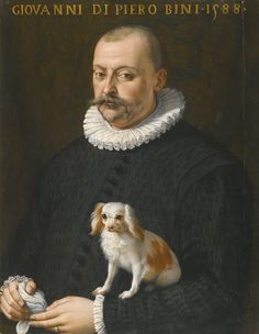 ATTRIBUTED TO GIOVANNI MARIA BUTTERI FLORENCE 1540 - CIRCA 1606 PORTRAIT OF GIOVANNI DI PIERO BINI, HALF LENGTH, WEARING A BLACK DOUBLET AND HOLDING A DOG inscribed and dated along the upper edge: GIOVANNI DI PIERO BINI . 1588 oil on panel 88.5 by 68.5 cm.; 34 7/8 by 27 in.