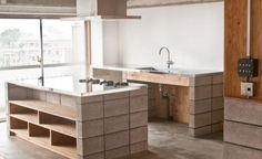 Remodelista: low budg diy kitchen for serious cooks...concrete blocks and polished steel countertops