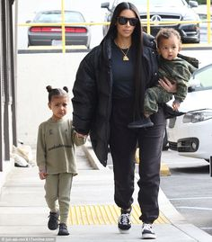 Wow: On Sunday, a casual looking Kim Kardashian stepped out for lunch in Calabasas with her husband Kanye West and their two children: North, three, and Saint, one