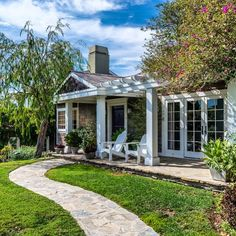 Idyllic right? #1651Capri is a classic #CapeCod style home in #PacificPalisades. I love every thing about it - beautiful grounds great views and charming details.  Available #forlease  To learn more please visit the #linkinbio | cindyambuehl.luxury | #luxuryrealestate #realestate #luxuryrental #homeforrent #homeforlease #rental #forrent #curbappeal #frontporch #adirondackchairs #timetorelax #theagencyre