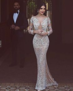 Heavily beaded evening gowns like this don't have to cost a fortune. Our dress design firm is located near Dallas Texas and can make elegant beaded #eveningdresses for a very reasonable price. In addition to custom designs we also can make #replicadresses for those clients who love a haute couture gown but it is out of their price range. Your custom dress will be styled the same as the original but cost way less. Contact us directly for pricing at www.dariuscordell.com