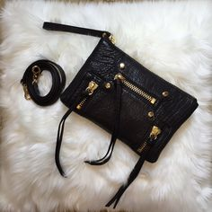 Bookies New York black with gold zipper crossbody New with tag! Beautiful black pebbled leather mini crossbody with gold zipper detail. Can remove crossbody straps and use as a wristlet. Comes with Botkier dustbag Botkier Bags Crossbody Bags