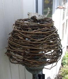 I LOVE this lampshade.  Made with curly willow branches & a paper mache bird finial.
