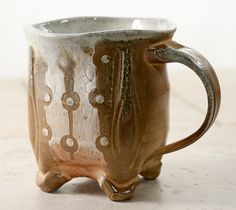 interesting mug with feet by Keith Phillips