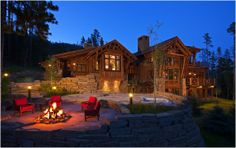 Fabulous Montana log home with amazing landscaping.  Elevated rock wall with hot tub and firepit and indirect pathway lighting