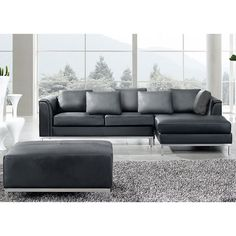 The sleek modern design coupled with comfort takes the family room to the next level. The L-shape leather sofa comes with an open face section that can be used like a chaise lounge while the ottoman can be used as a table or foot rest.