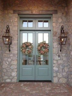 Bevolo gas lights on beautiful stone house