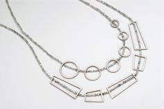 Framed necklace in 18 carat white gold with grey diamond beads by Daphne Krinos.