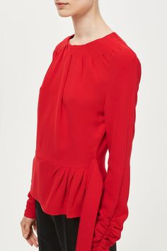 Opt for a statement-making hue this season with this peplum top in red by Boutique. Adorned with extra details like pleating to the neck and ruched sleeves, it's ideal for styling with dark-wash, straight leg jeans. Made in Britain.