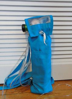 """B Tank Turquoise Oxygen Backpack by myscap on Etsy Frees up hands to do other things.......like shopping and playing with grand-kids!!!!!!!!!!!! Height: 16"""" Fits oxygen tanks.:M6,M9,B, &C Features: Plastic gauge viewer, Side Fastener for tubing, 1/4"""" padding, Outside Pockets, D-ring fastener, 1""""wide adjustable straps, Fully lined, Triple stitching in stress areas For more stability, purchase with waist belt. USPS with tracking. international orders insured"""