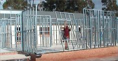 A photo of a house being framed using lightweight steel. It takes a lot of energy to produce this material, and it can present a horrible thermal bridge problem if not mitigated by a thermal barrier. Steel Frame House, Steel House, Building Systems, Building Materials, Colorbond Roof, Exterior Wall Panels, Steel Framing, Sawn Timber, Modular Walls