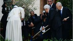 Palestinian leader Mahmoud Abbas (C), Pope Francis (L) and Israeli President Shimon Peres (R) plant an olive tree after a joint peace prayer...