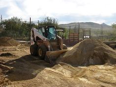 Rammed Earth House - Mixing Earth and Cement