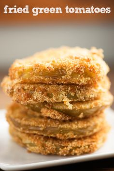 Ever wondered how to make fried green tomatoes? This is my favorite fried green tomatoes recipe and I think you'll love it, too! The cajun remoulade makes a great dip. I am not a gardener. Okra, Vegetable Dishes, Vegetable Recipes, Cajun Remoulade, My Favorite Food, Favorite Recipes, Green Tomato Recipes, Fried Green Tomatoes, Side Recipes