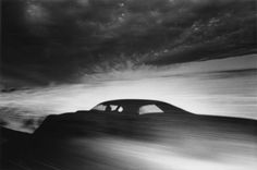 "IKKO NARAHARA | Shadow of car driving through desert, Arizona, from the series ""Where Time Has Vanished"", 1971"