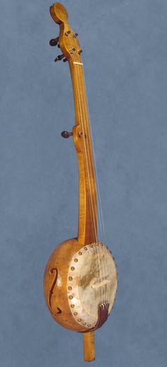 Gourd banjo I think this banjo is gorgeous. Made in the old style with fretless neck.