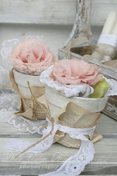 Shabby pots wrapped in vintage paper and lace and filled with shabby roses ♡