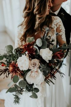 Blush, ivory, and green winter wedding bouquet | Image by Peyton Rainey Photography and Chelsea Denise Photography