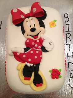 Minnie Mouse cake with traditional red and yellow colors. Filled with fresh strawberries and whipped cream. - Custom made by: www.kitchensweetz.com