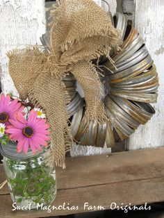 Mason Jar Lid Wreath. Would be a great addition to the cabin!