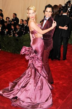 Amber Heard, with Zac Posen, wears a Zac Posen gown and Tiffany & Co. jewelry.