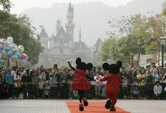DISNEY-SHANGHAI/ Mickey Mouse and Minnie Mouse characters greet visitors with their latest Year of the Mouse costumes at Hong Kong Disneyland in this January 21, 2008 file photo.