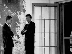 The Kennedy brothers conferring during the Cuban Missile Crisis.