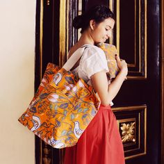 Beach Bag in Luca Orange Tangerine with the Traveller's Clutch