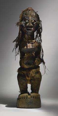 Songye Community Power Figure, Democratic Republic of the Congo with attachments of Domestic Chicken (Gallus gallus) feathers and Common Waterbuck Antelope (Kobus ellipsiprymnus) hide. Height: 36 in cm) Indonesian Art, African Sculptures, Les Continents, Africa Art, New York Art, Tribal Art, Magazine Art, Republic Of The Congo, Art Dolls