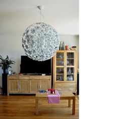Kvetana - Chandelier made of kitchen colanders and plastic bottles