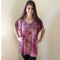 Boho Style Tribal Embroidered Top Stunning Boho Style Tribal Embroidered Top.  Beautiful flutter sleeve detail.  Lightweight and flowy.  Color is azuki.  Also available in charcoal-see separate listing.  Modeling size S.  Price firm unless bundled.                                                  ▪️60% Cotton 40% Polyester                                  ▪️Dry Clean ONLY      🚫Trades Boutique Tops Blouses