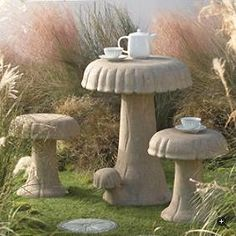 Cement mushroom table and stools.