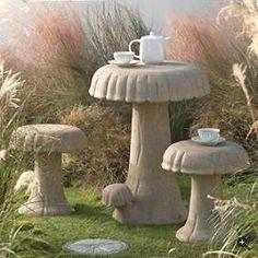 Cement mushroom table and stools.