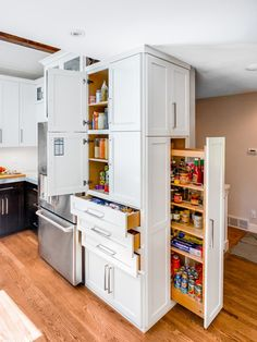 Not only are these kitchen closets convenient, but they are also sleek looking. It would be like hvaing a stylish stock room but without the dungy and musty feel.