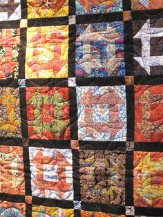 Kaffe Fassett/ Liberty of London churn dash quilt, spotted at Houston quilt market 2010, photo by SUPPOSE - create - delight