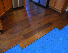 Installing A Laminate Floor Over Quietwalk Acoustic Underlayment In Kitchen Remodel Helps Smooth Out Imperfections The Subfloor And Quiets