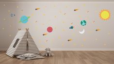 Galaxy / outer space themed nursery art from Starlight Baby. Premium wall decals - including the sun, moon, planets, meteors, spaceships, shooting stars, and more! Great for a space-themed bedroom. Peel. Stick. Enjoy.