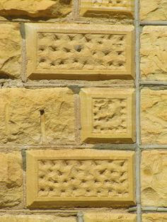 Decorative limestone on a building in Hill City, Kansas