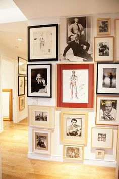 Love this gallery style of going all the way to the floor and all the way to the ceiling.- choose a wall and reframe favorite pieces to all be displayed together