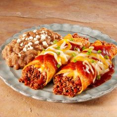 Beef Enchiladas Rancheros – try this baked dish of browned ground beef, tomatoes and enchilada sauce wrapped in corn tortillas! You can even top it off with more enchilada sauce and cheese for a flavor-packed weeknight dinner! Enchilada Recipes, Meat Recipes, Mexican Food Recipes, Cooking Recipes, Enchilada Sauce, Yummy Recipes, Dinner Recipes, Skillet Recipes, Mexican Recipes