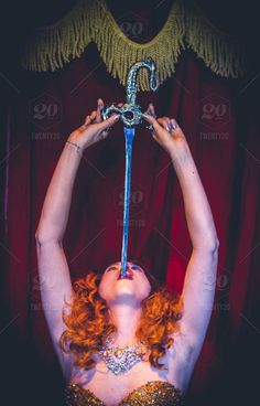 stock photo, ginger, lipstick, redhead, sword, sexy, sideshow, burlesque, peepshow, freak-show, sword-swallower