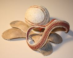 Baseball bracelet -- cut stitches from leather with exacto knife, cut leather to bracelet length, but leave string long for tying