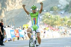 Peter Sagan wins Stage 2 of the Tour of Oman. He had enough time to celebrate, first pointing at the Slovak emblem on his jersey then raising his arms aloft for a more traditional victory salute. Look. Cycling Clothing, Cycling Outfit, Love To Meet, Cyclists, Time To Celebrate, Biking, Victorious, Celebrities, Easy
