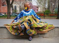 """Another pinner wrote, """"Stunning!  This was too beautiful to pass up. My attempt to find out the designer of this garment proved unsuccessful.  If anyone knows who created this garment and photo please place your comment below.  Thanks.  In the meantime have fun with a search using the term """"modern African style clothing for women"""""""""""