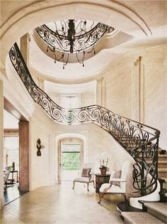Foyer and stairs, interior design ideas and home decor ~ Renovation of Villa Maria, in Water Mill, NY, by architect Andre Tchelistcheff and designer Carol Egan. Architectural Digest, Architectural Features, Grand Staircase, Staircase Design, Spiral Staircase, Black Staircase, Grand Foyer, Long Island House, Architecture Design