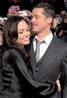 Brad Pitt and Angelina Jolie's Cutest Couple Moments - In Japan, 2009 from InStyle.com