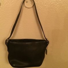 Coach Purse This little cutie is 6 x 8 inches in size. It's smooth black leather is soft to the touch. It has an adjustable strap with silver hardware. Coach Bags
